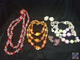 (3) multi strand necklaces, and set of clip on earrings