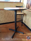 (3) large round single pedestal tables, measuring 42 in tall and 30 in in diameter ((SOLD TIMES THE
