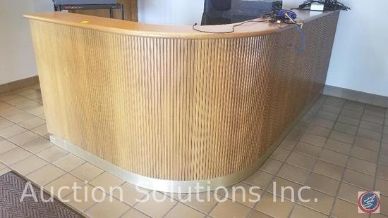 Front office reception desk approximately 105 x 57 x 42 inches tall made of oak