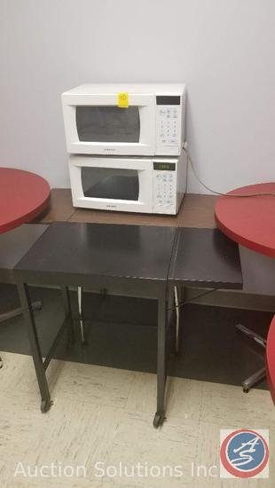 Two small Samsung microwaves, folding table, 8 foot folding table, coffee maker, and a whirlpool ice