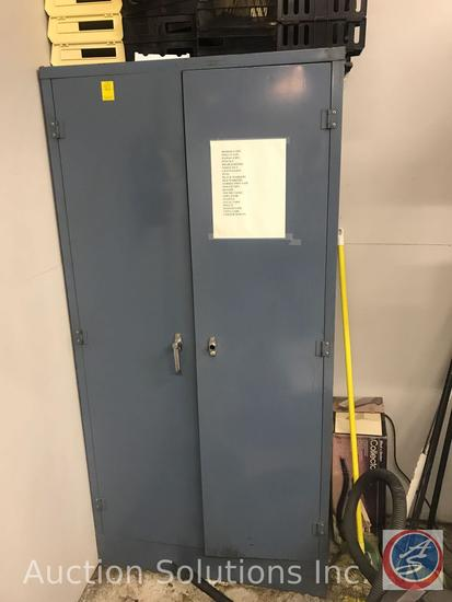 Steel storage cabinet (missing handle) and contents