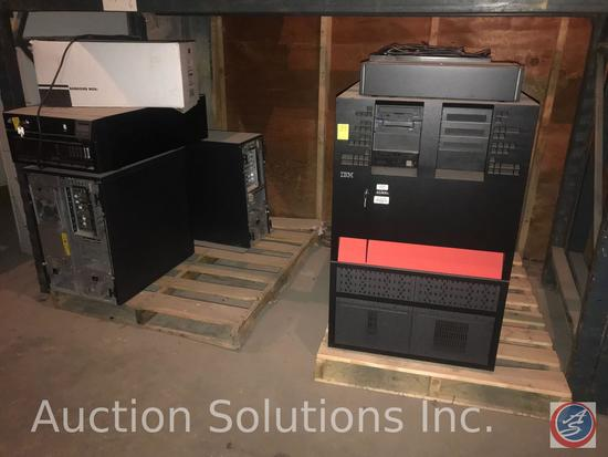 IBM mainframe components (AS400), file cabinet, and assorted desks.