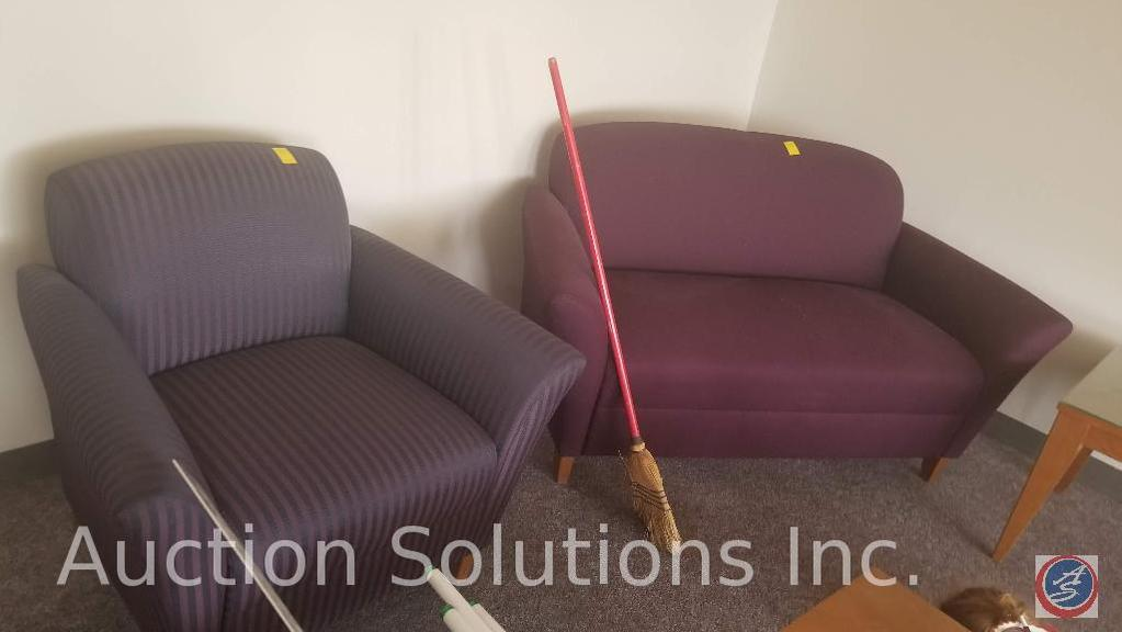 Maroon love seat and a purple and black striped chair