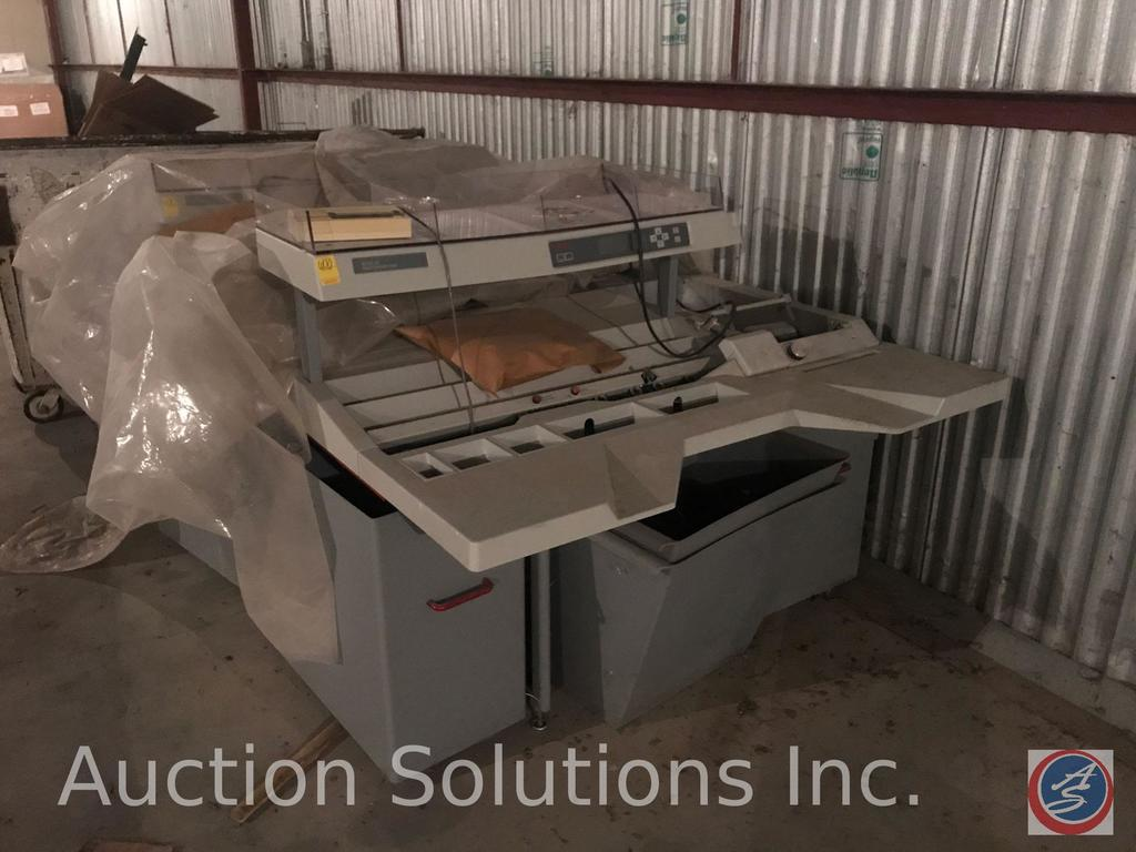 Contents of room 600 including 2 model 600 rapid extraction desks, Minolta EP 5050 copy center, 2