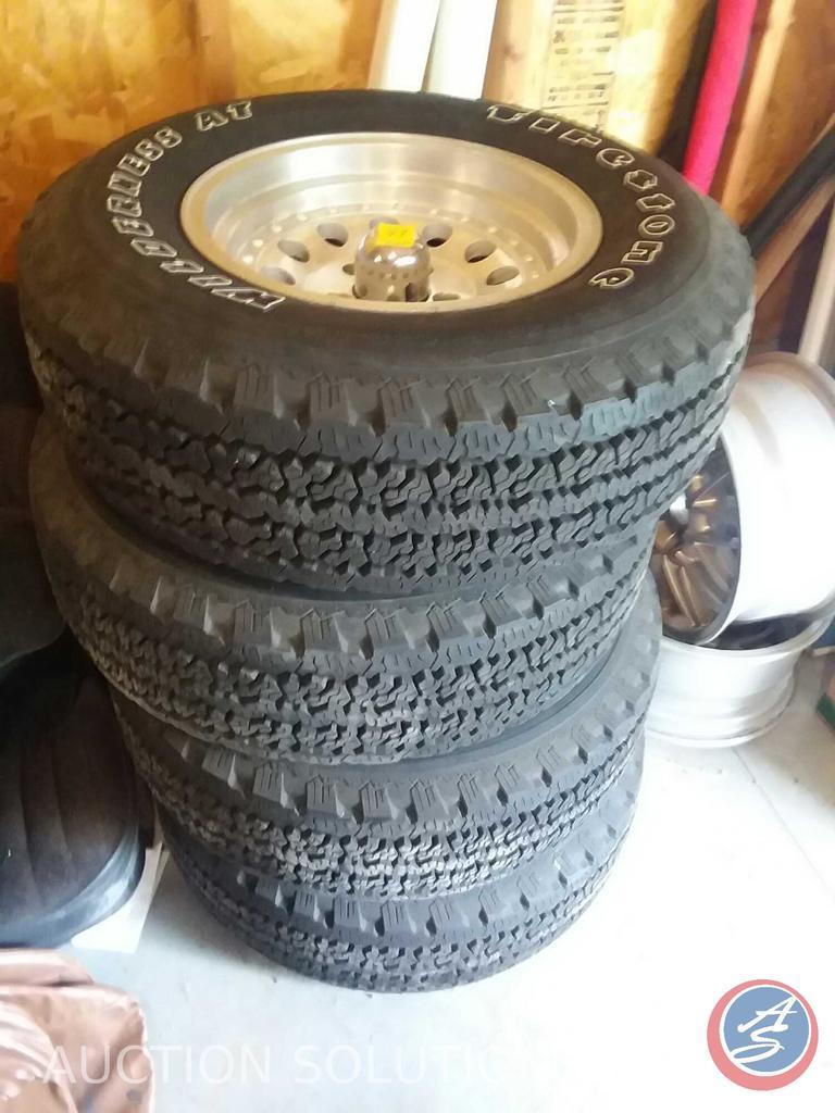 (4) Firestone Wilderness AT tires (P235/75R15-105S)