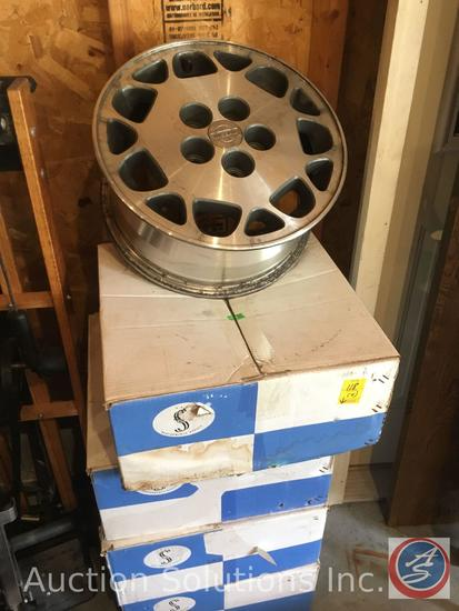 Set of 4 Nissan Alloy rims, in boxes Part No S40565014 Size 15 x 6.5 Bolt Circle 5 x 4.25 5 x 4.5