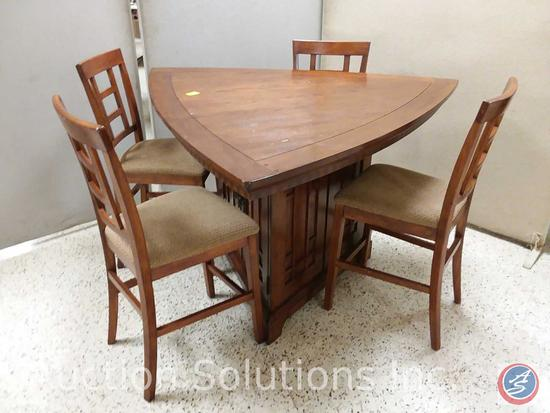 Ashley triangle shaped medium brown oak counter height table (60x60x60x 36.5 tall) with base storage