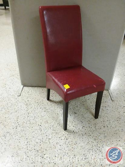 Red padded dining chair