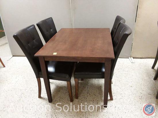 Wood dining table (48x36x30) and (4) black padded chairs {{SOME MATERIAL DAMAGE}}
