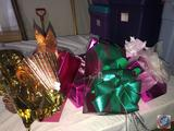 Faux Christmas Gifts in Assorted Wrapping Paper with Hand-made Bows in Rubbermaid Tote