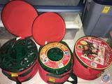 One New St. Nick's Choice Three Holiday Reel and Two Used Holiday Reels in Red Carrying Cases