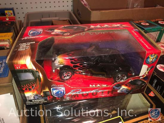 [3] Burago Scale Model Cars in Original Boxes; and a Plymouth Prowler Battery-Op Radio Controlled