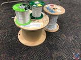 2 partial spools of wire measuring tape, one partial spool of 18ga plenum cable and one spool of