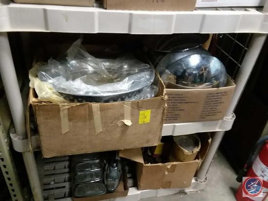 2 boxes of vintage hubcaps
