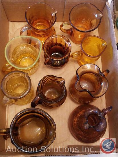 (10) Small Amber Glass Small Pitchers