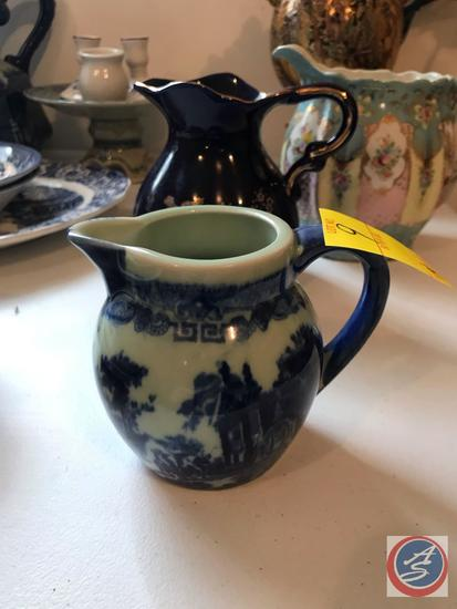 (4) Pitchers Including a Vintage Floral Pitcher, Dark Blue Pitcher, Water Pitcher, and Cream Pitcher