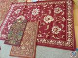 Garen Ridge 5' x 7' Maroon Area Rug, and (2) Carved Maroon Entry Rugs