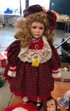 Doll on a Stand Dressed in Holiday Attire