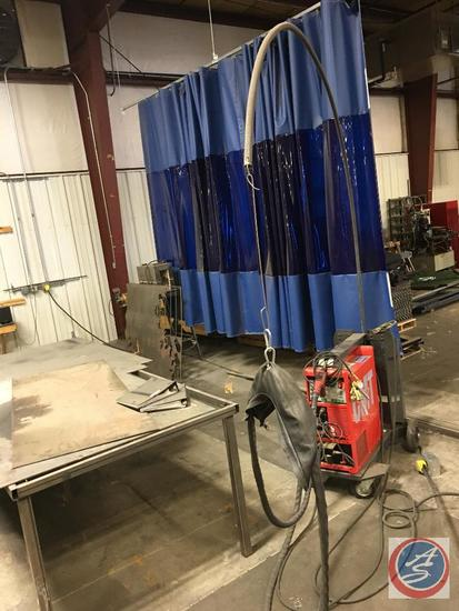 Adjust a Wall welding curtain with tracks approximate total length of curtain is 148-150 feet and 10