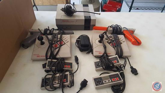 Super Nintendo NES Model No. NES-001, (2) Nintendo Guns, (2) Nintendo Joystick Controls, (2) Hand