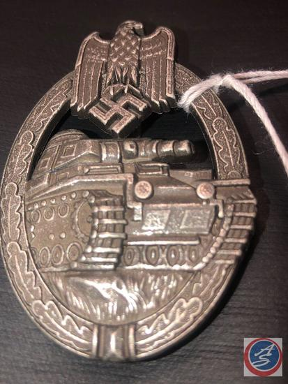 German WWII Silver Tank Assault Badge. The front shows a tank in the center with a German eagle