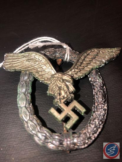 German WWII Luftwaffe Pilot Badge. The reverse side is maker marked A. Has a thin vertical pin back.