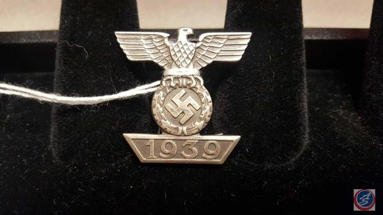 German WWII 2nd Class Clasp to the Iron Cross. The front shows a German eagle clutching a swastika
