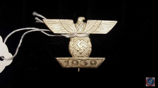 German WWII 1st Class Clasp to the Iron Cross. The front shows a German eagle clutching a swastika