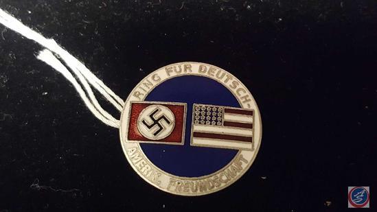 German World War II American Bund Party Badge. Measures 1 1/16 in diameter. The front reads Ring Fur