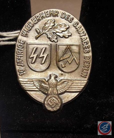 "German WWII Waffen SS / SA Gautag Berlin Badge. Measures 1 3/8 wide by 1 3/4"" tall. The front shows"