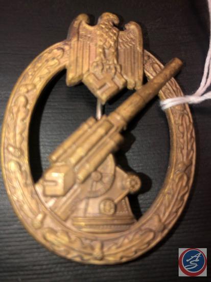 German WWII Army Flak Artillery Badge. The reverse side is maker marked C E Junker Berlin SW. Has a