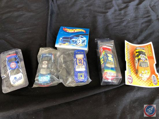 Five sealed collectible race cars