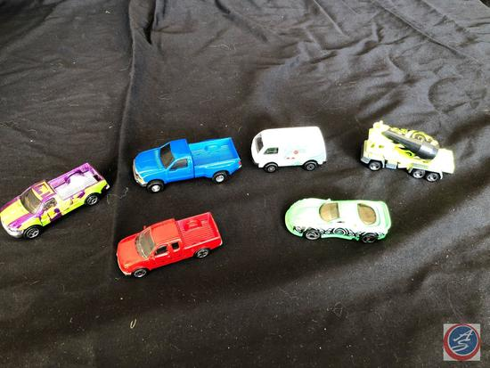Six collectible cars and trucks