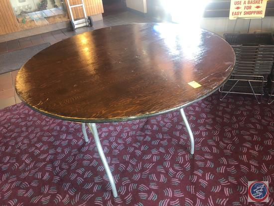"Round Folding Table Measuring 48"" X 30"""