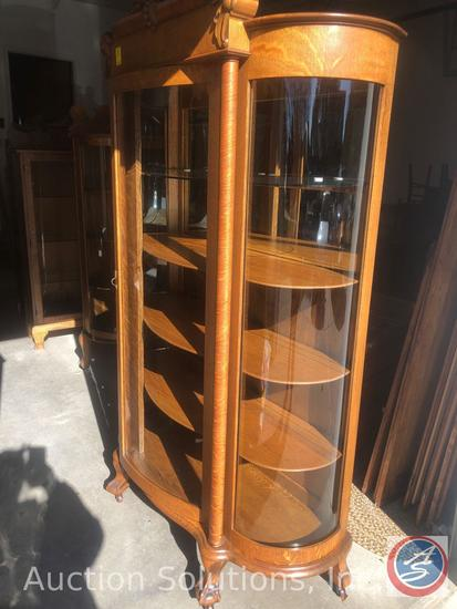 Antique 5 Shelf Curved Glass Curio Cabinet with Hand Carved Lion Detailing on Top and Eagle Claw