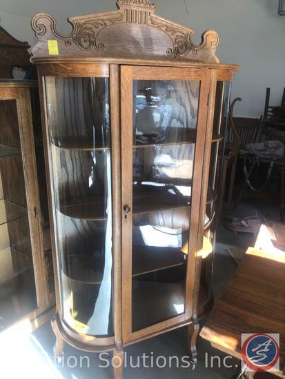 Vintage 4 Shelf Curved Glass Curio Cabinet on Castors with Hand Carved Detailing on Top Measuring