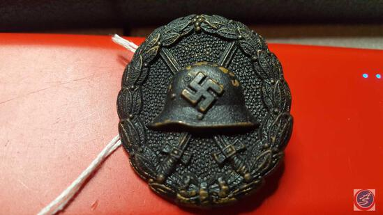 German WWII Black Condor Legion Wound Badge. The front shows a German helmet with a pair of crossed