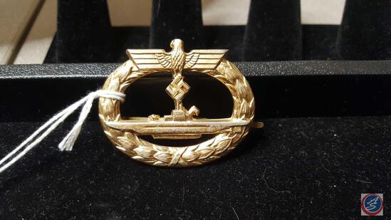 German WWII Naval Kriegsmarine U-Boat Submarine Badge. The front shows the profile of a German