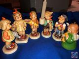 M.I. Hummel I Brought You A Gift Figurine Marked 479. M.I. Hummel Boy with Candle Figurine Marked