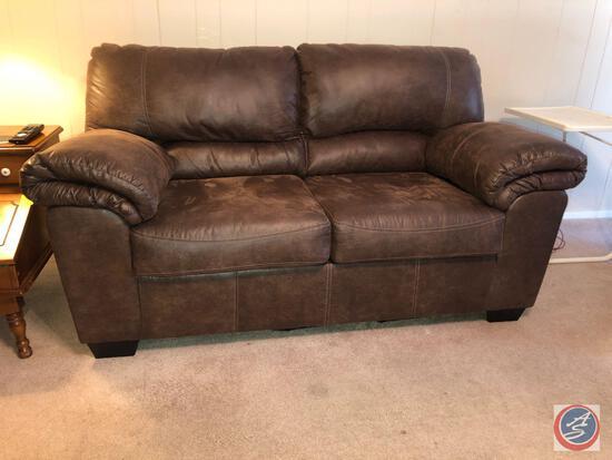 "Ashley Furniture Love Seat Measuring 60"" X 35"" X 31 1/2"""