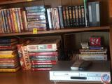 VHS Tapes Including Titles Such As 3,2,1 Penguins!, Winnie the Pooh Boo To You Too!, Elmo in