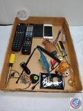 Flat remotes,cell phones, screw drivers, wind up dinosaur, misc.