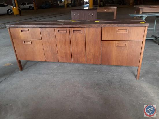 Antique / vintage wood credenza with two doors on the left, two doors on the right, and two bifold