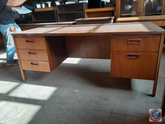 Antique / vintage wood desk with three drawers on the left and two drawers on the right. There is a