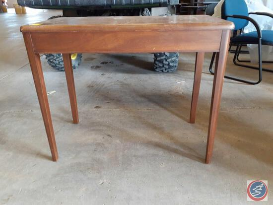 Antique / vintage wood table; approximate measurements are 36In. wide x 19In. deep x 29In. high;