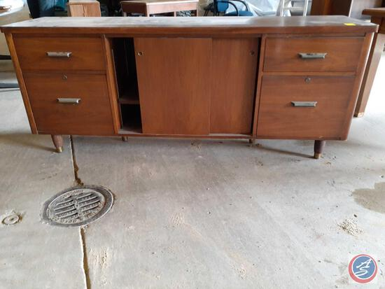 Antique / vintage wood credenza with two drawers on the left, two drawers on the right, and two
