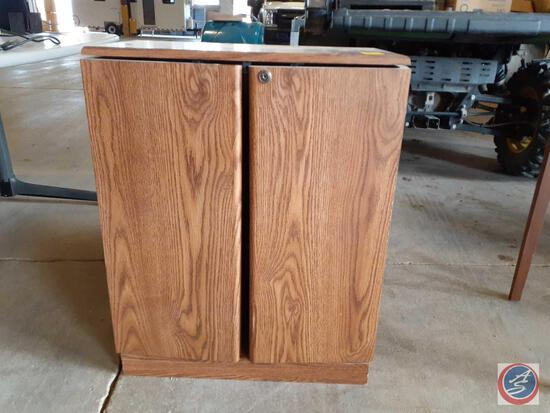 VHS cabinet with two cabinet doors and three shelves; approximate measurements are 23-1/4In. wide x