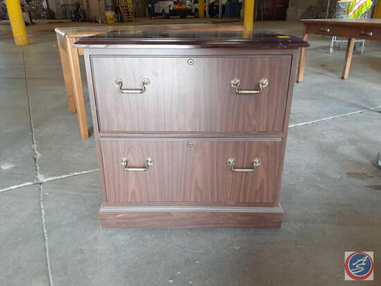 Wood laminate two drawer lateral filing cabinet; approximate measurements are 32In. wide x 21-1/2In.