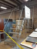 Warehouse platform ladder with 36In. wide x 58In. deep platform with a 5' 10In. standing height and