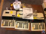 (3) calculators: Two (2) are a 10 digit Canon model CP1013D calculator and one (1) is a 12 digit